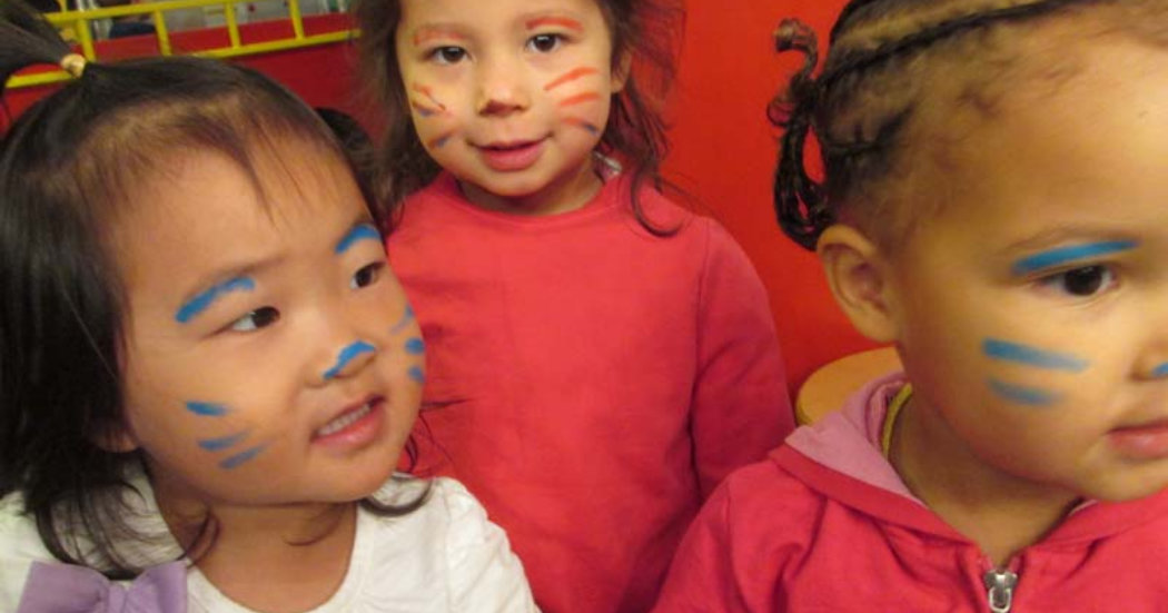 little girls with paintings in their face