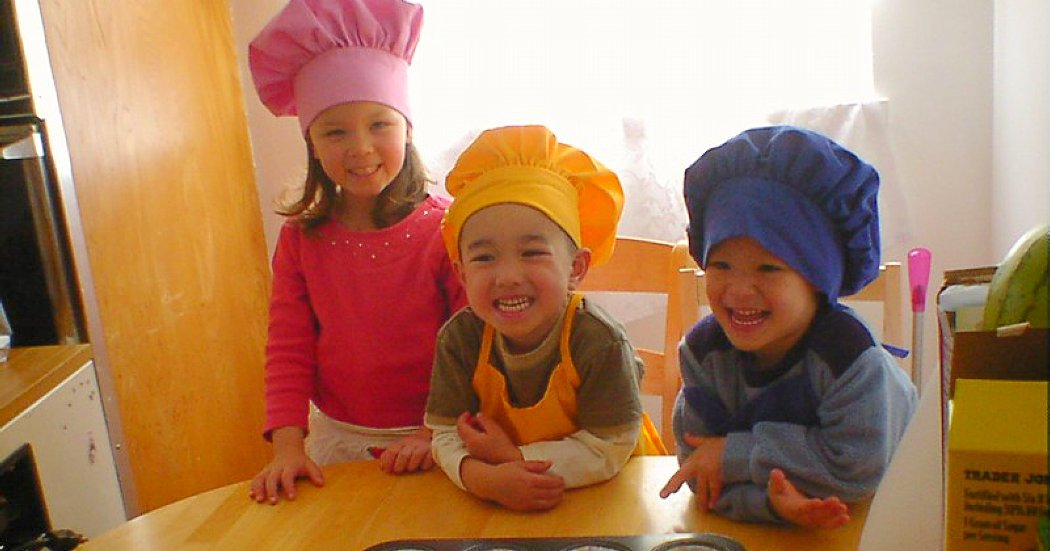 cooking session with three little child