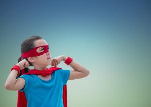 girl in superhero costume standing